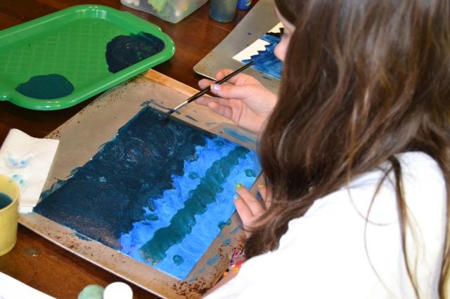 Ella painting a storm