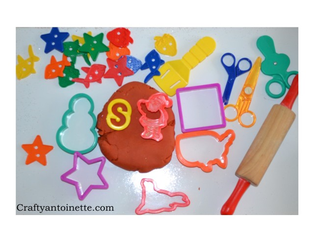 Next up... Play dough! We have a snowman, letter S, Santa, square, united States, star, seal, scissors, spatula and lots of other stars and strawberries.