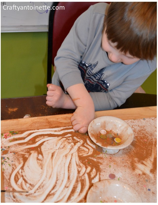While I went to hang up his art, he started to play around with the cinnamon mixture.